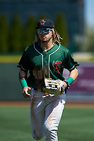 Great Lakes Loons right fielder Niko Hulsizer (40) jogs off the field between innings of a Midwest League game against the Wisconsin Timber Rattlers at Dow Diamond on May 4, 2019 in Midland, Michigan. Great Lakes defeated Wisconsin 5-1. (Zachary Lucy/Four Seam Images)