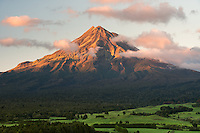Sunrise over Taranaki, Mt. Egmont with farmland in foreground, Taranaki Region, North Island, New Zealand, NZ