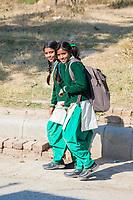 India, Dehradun.  Two School Girls Walking.