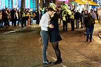 Pictured: A couple kiss in the middle of the road. Sunday 31 December 2017 and 01 January 2018<br /> Re: New Year revellers in Wind Street, Swansea, Wales, UK