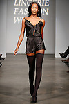 Model walks runway in lingerie during the Lingerie Fashion Week Fall 2014 closing show on February 22, 2014.