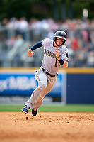 New Orleans Baby Cakes shortstop J.T. Riddle (10) running the bases during a game against the Nashville Sounds on May 1, 2017 at First Tennessee Park in Nashville, Tennessee.  Nashville defeated New Orleans 6-4.  (Mike Janes/Four Seam Images)