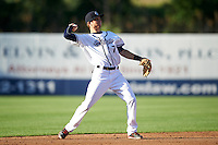 Syracuse Chiefs shortstop Trea Turner (7) throws to first base during a game against the Louisville Bats on June 6, 2016 at NBT Bank Stadium in Syracuse, New York.  Syracuse defeated Louisville 3-1.  (Mike Janes/Four Seam Images)