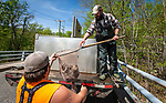 WINSTED, CT 050721JS01—Dave Piera, right and Cody Lessard, both with the DEEP Burlington Fish Hatchery, work on stocking the Still River in Winsted with trout on Friday. The pair were also stocking other waterways in the area. <br /> Jim Shannon Republican American