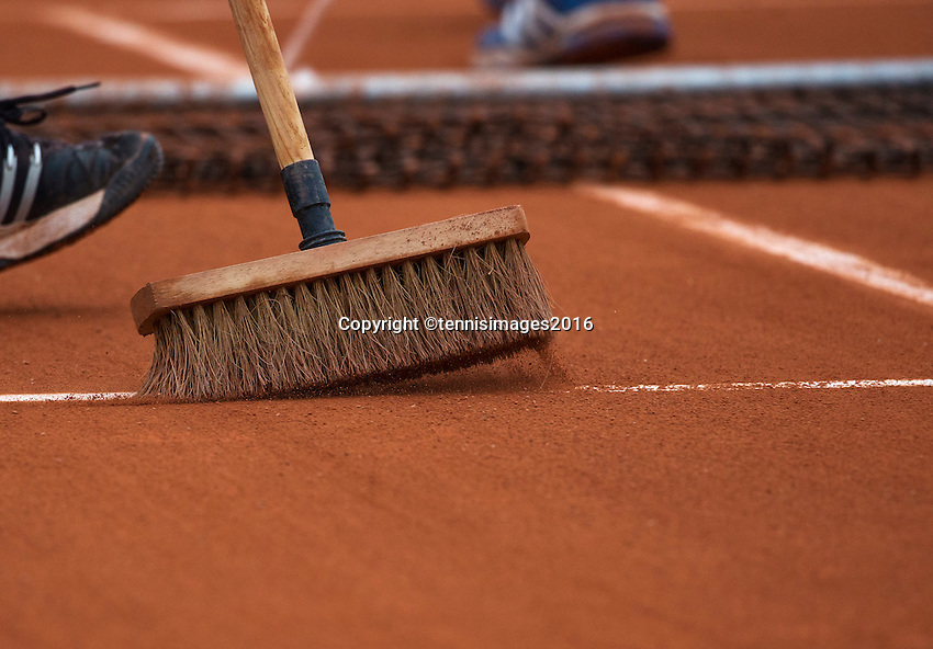 Paris, France, 28 June, 2016, Tennis, Roland Garros, court maintanance, net tweeping clay and broom tweeping the line.<br /> Photo: Henk Koster/tennisimages.com