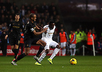 Wednesday, 01 January 2014<br /> Pictured L-R: Vincent Kompany of Manchester City challenges Roland lamah of Swansea. <br /> Re: Barclay's Premier League, Swansea City FC v Manchester City at the Liberty Stadium, south Wales.