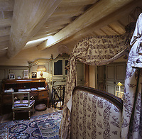 A Regency desk in a corner of the attic master bedroom stands against the late 18th-century Piedmontese wooden panelling that lines the walls