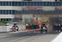 May 22, 2011; Topeka, KS, USA: NHRA top fuel dragster driver Tony Schumacher (right) alongside David Grubnic during the Summer Nationals at Heartland Park Topeka. Mandatory Credit: Mark J. Rebilas-