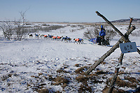 Sunday March 11, 2007   ----   Martin Buser runs past a trail marker as he nears Unalakleet on Sunday afternoon in third place.