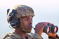 African American US military soldier in uniform outside in the desert. For sale as stock photography, DOD compliant.