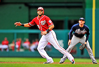 25 September 2011: Washington Nationals outfielder Michael Morse watches a ball trajectory from first base during a game against the Atlanta Braves at Nationals Park in Washington, DC. The Nationals shut out the Braves 3-0 to take the rubber match third game of their 3-game series - the Nationals' final home game for the 2011 season. Mandatory Credit: Ed Wolfstein Photo