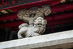 Bat and Qilin stone sculpture under the front roof of the Temple.