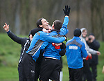 Rangers manager Ally McCoist laughing with players Bilel Mohsni and Lee McCulloch after putting singer James Arthur out at Rangers training