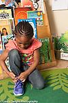 Education Preschool 4-5 year olds girl tying own shoe
