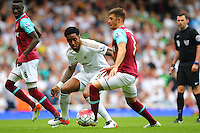 Leroy Fer  of Swansea and Aaron Cresswell of West Ham United   during the Barclays Premier League match between West Ham United and Swansea City  played at Boleyn Ground , London on 7th May 2016