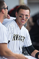 Trayce Thompson (15) of the Charlotte Knights is all smiles during the game against the Gwinnett Braves at BB&T BallPark on July 3, 2015 in Charlotte, North Carolina.  The Braves defeated the Knights 11-4 in game one of a day-night double header.  (Brian Westerholt/Four Seam Images)