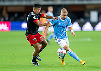 WASHINGTON, DC - APRIL 17: Edison Flores #10 of D.C. United fights for the ball with Anton Tinnerholm #3 of New York City FC during a game between New York City FC and D.C. United at Audi Field on April 17, 2021 in Washington, DC.
