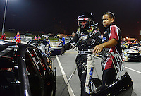Sept. 16, 2012; Concord, NC, USA: NHRA crew member for pro mod driver Leah Pruett during the O'Reilly Auto Parts Nationals at zMax Dragway. Mandatory Credit: Mark J. Rebilas-
