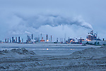 The Syncrude smokestacks spew emissions into the air. Average greenhouse gas emissions for oil sands extraction and upgrading are estimated to be 3.2 to 4.5 times as intensive per barrel as for conventional crude oil produced in Canada or the United States.