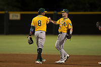AZL Athletics shortstop Alexander Campos (8) and Nick Ward (4) celebrate after an Arizona League game against the AZL Giants Black at the San Francisco Giants Training Complex on June 19, 2018 in Scottsdale, Arizona. AZL Athletics defeated AZL Giants Black 8-3. (Zachary Lucy/Four Seam Images)