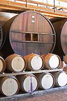 Oak barrel aging and fermentation cellar. Fermentation tanks. Mas Montel, Sommieres, Languedoc, France
