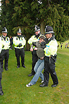 Merthyr Tydfil - UK - 26th April 2012 : Anti- Monarchy protestor is marched away by police during The Queen and Prince Philip's visit to Cyfarthfa Castle museum and art gallery in Merthyr Tydfil this afternoon.  The Queen and Prince Philip are visiting towns and cities all over the United Kingdom to mark the Diamond Jubilee year.