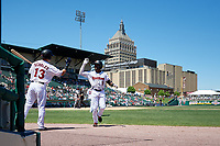 Rochester Red Wings Jaylin Davis (9) high fives Brian Schales (13) after a home run during an International League game against the Scranton/Wilkes-Barre RailRiders on June 25, 2019 at Frontier Field in Rochester, New York.  Rochester defeated Scranton 10-9.  (Mike Janes/Four Seam Images)