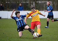 20140104 - AALTER , BELGIUM : Brugge's Ingrid De Rycke pictured tackling Massenhoven's Sofie Haesmans (r) during the female soccer match between Club Brugge Vrouwen and Massenhoven VC , of the 1/8 final matchday in the Belgian Women Cup competition. Saturday 4 January 2014 . PHOTO DAVID CATRY