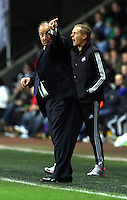 Swansea, UK. Thursday 20 February 2014<br /> Pictured: Managers Garry Monk (R) of Swansea and Rafa Benitez (L) of Napoli<br /> Re: UEFA Europa League, Swansea City FC v SSC Napoli at the Liberty Stadium, south Wales, UK