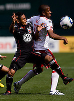 Andy Najar (14) of D.C. United is shielded away from the ball by Jeremy Hall (17) of the New York Red Bulls at RFK Stadium in Washington, DC.  The New York Red Bulls defeated D.CC United, 2-0.