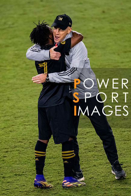 Latif Blessing of Los Angeles FC (USA) celebrates with Head Coach Bob Bradley after scoring his team's third goal against Club America (MEX) during their CONCACAF Champions League Semi Finals match at the Orlando's Exploria Stadium on 19 December 2020, in Florida, USA. Photo by Victor Fraile / Power Sport Images