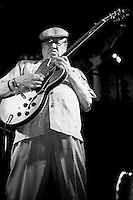 "Dennis Coffey plays his guitar at the 8th annual Ponderosa Stomp, held at the House of Blues in New Orleans on April 28, 2009. <br /> <br /> Coffey is a noted guitar player from Michigan, known for his work as a member of the ""Funk Brothers"" studio band playing on numerous hits for Motown Records.  Coffey also recorded his own gold record selling instrumental ""Scorpio"", which led him to perform on the television show ""Soul Train"" in 1972, the first white musician to do so.    <br /> <br /> The Ponderosa Stomp is an annual music festival held in New Orleans since 2002 that celebrates the uncelebrated names in American musical history.  The festival spotlights musicians who have contributed to the American roots musical canon in various genres, from rockabilly to soul to rock and roll to jazz to experimental.  For two nights of the year these mostly forgotten names perform to an audience of aficionados whose memory has not faded and turn back the clock with blistering performances of the hits that did or (in the case of the regional musicians that plugged away unknown to the world at large, as well as those whose songs were recorded to acclaim by other musicians) did not make them famous.  <br /> <br /> In addition to the two nights of performances the Ponderosa Stomp Foundation (the non-profit founded by the eccentric Dr. Ira Padnos and his coterie of like minded music fanatics the Mystic Knights of the Mau Mau) also produces two days of the Music History Conference, where many of the performers, as well as other music industry names, share stories of their lives in the business.  The Conferences take place in the Louisiana State Museum at the Cabildo in Jackson Square."