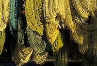 AJ2382, British Virgin Islands, fihing nets, Tortola, Caribbean, Virgin Islands, BVI, B.V.I., Yellow fishing nets hanging to dry at Brewer's Bay on the island of Tortola on the British Virgin Islands.