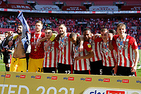 29th May 2021; Wembley Stadium, London, England; English Football League Championship Football, Playoff Final, Brentford FC versus Swansea City; Goalkeeper David Raya, Goalkeeper Luke Daniels, Sergi Canos, Henrik Dalsgaard, Bryan Mbeumo, Ethan Pinnock, Marcus Forss and Mads Roerslev of Brentford all celebrate with their winners medals  after they won 2-0 and promoted to the premier league