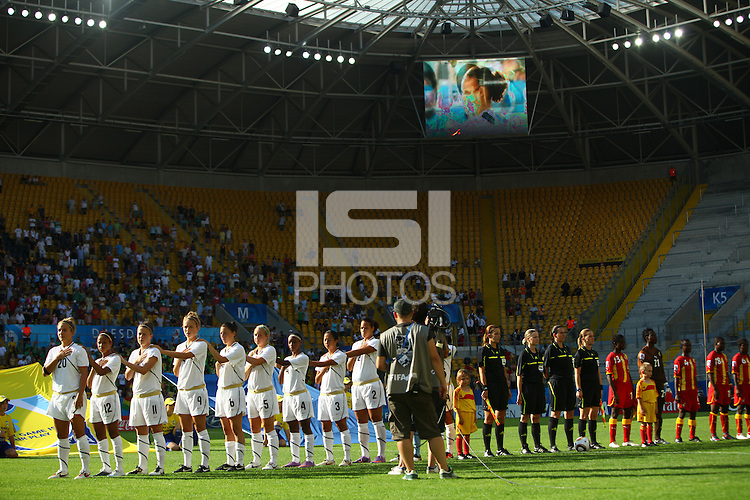 Team USA (L) and Team Ghana during the opening ceremony during the FIFA U20 Women's World Cup at the Rudolf Harbig Stadium in Dresden, Germany on July 14th, 2010.