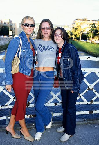 Sarajevo, Bosnia. Three fashionable young women on a bridge.