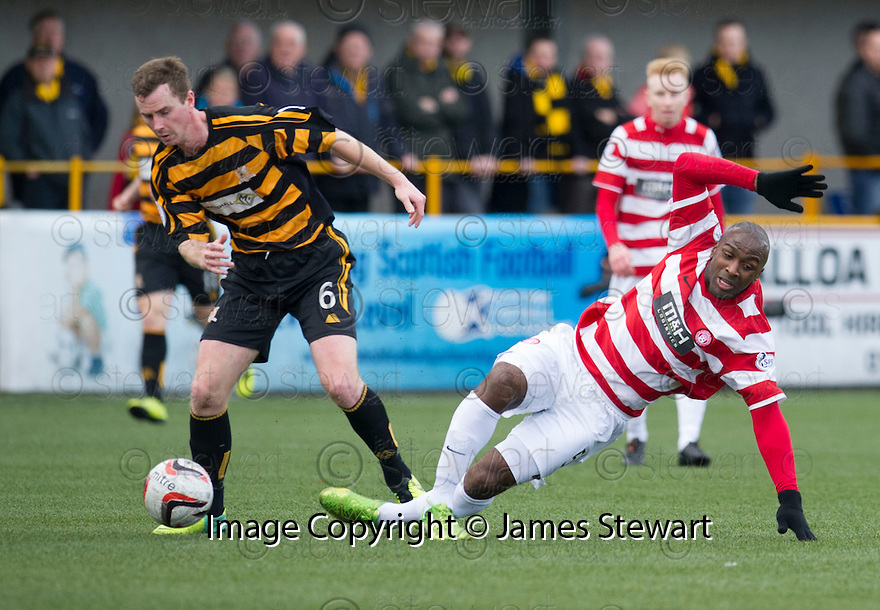 Hamilton's Jason Scotland goes down under a challenge from Alloa's Stephen Simmons.