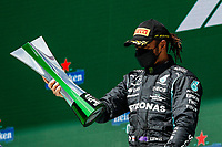 HAMILTON Lewis (gbr), Mercedes AMG F1 GP W12 E Performance, portrait celebrating his victory at the podium during the Formula 1 Heineken Grande Prémio de Portugal 2021 from April 30 to May 2, 2021 on the Algarve International Circuit, in Portimao, Portugal <br /> FORMULA 1 : Grand Prix Portugal - Essais - Portimao - 02/05/2021 <br /> Photo DPPI/Panoramic/Insidefoto <br /> ITALY ONLY