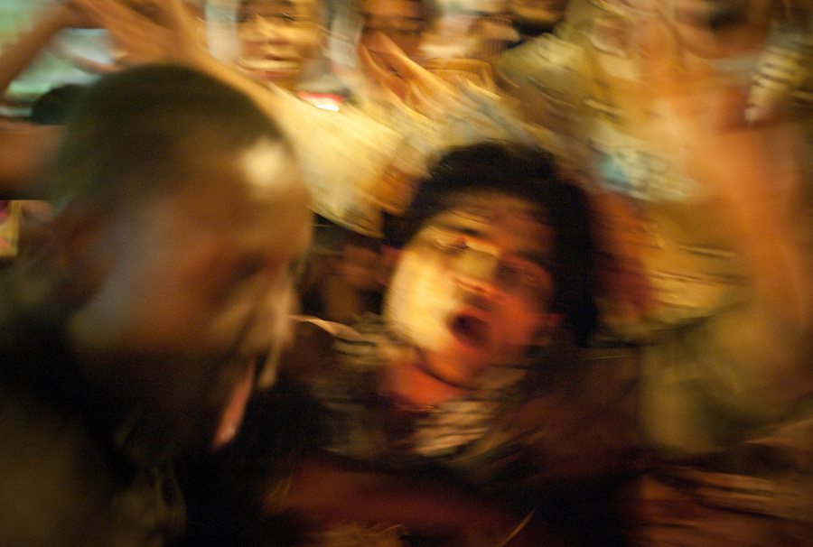Libyan youth dance and chant slogans after Mustafa Abdul-Jalil declares the liberation of Libya in Benghazi, Libya, Friday, October 23, 2011. Three days after the death of Muammar Gaddafi Libya's NTC leaders addressed a jubilant crowd at a ceremony in Benghazi to mark an official end to the revolution, and the start of a new beginning for the country.