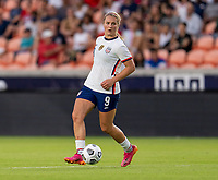HOUSTON, TX - JUNE 10: Lindsey Horan #9 of the USWNT dribbles the ball during a game between Portugal and USWNT at BBVA Stadium on June 10, 2021 in Houston, Texas.