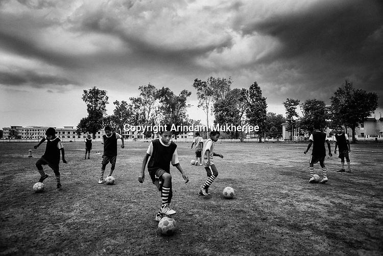 Students of Sukma Football academy practice in their ground at the educational complex in Sukma.Sukma, Chattisgarh, India. Arindam Mukherjee