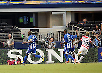 Eddie Johnson #26 of the USNMT scores a goal in the first  against Donis Escober #22 of Honduras on July 24, 2013 at Dallas Cowboys Stadium in Arlington, TX. USMNT won 3-1.