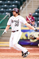 Luke Voit (30) of the Missouri State Bears follows through his swing during a game against the Evansville Purple Aces at Hammons Field on May 12, 2012 in Springfield, Missouri. (David Welker/Four Seam Images)