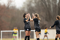 LOUISVILLE, KY - MARCH 13: Cece Kizer #5 and Emina Ekic #13 of Racing Louisville FC high five after a goal during a game between West Virginia University and Racing Louisville FC at Thurman Hutchins Park on March 13, 2021 in Louisville, Kentucky.