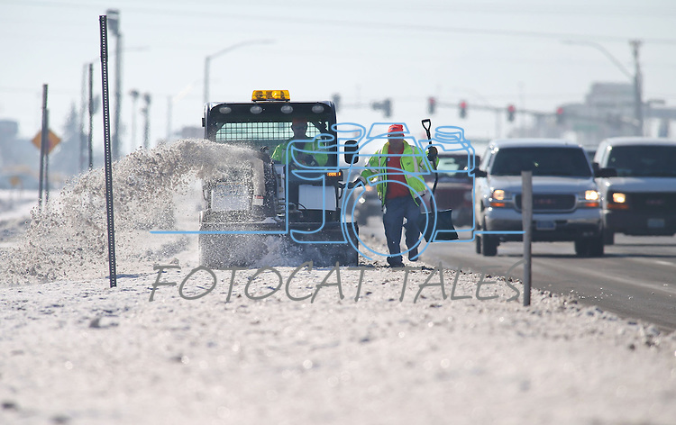 A crew clears snow off the sidewalks in Carson City, Nev., on Thursday, Dec. 12, 2013.<br /> Photo by Cathleen Allison
