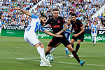 CD Leganes's Dimitrios Siovas and Atletico de Madrid's Saul Niguez during La Liga match between CD Leganes and Atletico de Madrid at Butarque Stadium in Madrid, Spain. August 25, 2019. (ALTERPHOTOS/A. Perez Meca)