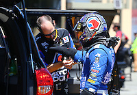 Jul. 28, 2013; Sonoma, CA, USA: NHRA crew member helping top fuel dragster driver Antron Brown during the Sonoma Nationals at Sonoma Raceway. Mandatory Credit: Mark J. Rebilas-