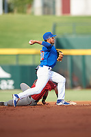 AZL Cubs 1 second baseman Oswaldo Pina (60) throws to first base to complete a double play during an Arizona League game against the AZL D-backs on July 25, 2019 at Sloan Park in Mesa, Arizona. The AZL D-backs defeated the AZL Cubs 1 3-2. (Zachary Lucy/Four Seam Images)