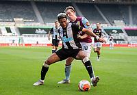Newcastle United's Joelinton shields the ball from Aston Villa's Matt Targett<br /> <br /> Photographer Alex Dodd/CameraSport<br /> <br /> The Premier League - Newcastle United v Aston Villa - Wednesday 24th June 2020 - St James' Park - Newcastle <br /> <br /> World Copyright © 2020 CameraSport. All rights reserved. 43 Linden Ave. Countesthorpe. Leicester. England. LE8 5PG - Tel: +44 (0) 116 277 4147 - admin@camerasport.com - www.camerasport.com