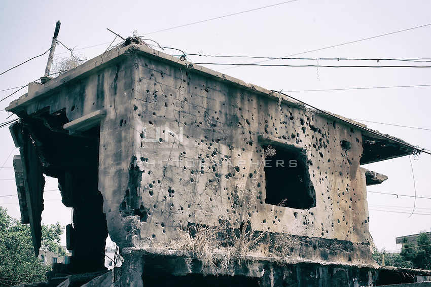 Building right at the entrance of the Shatila camp. During the three selling in 1971, 1982 and 1991 this building has resisted the Israeli buldozers. Vestige of the camp this building bears a the traces the oppression of Shatila. Shatila, Beirut. Lebanon 2015